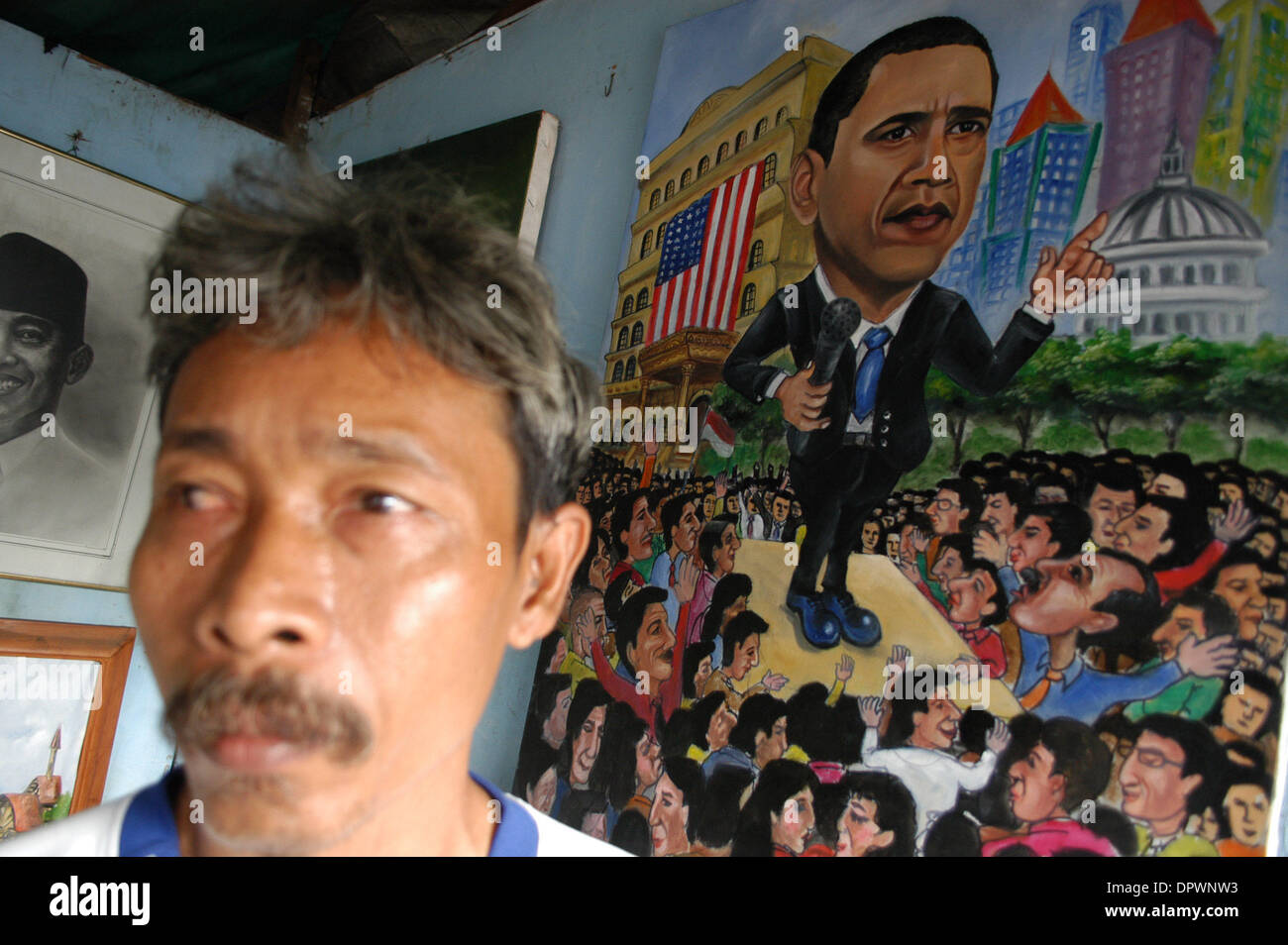 Jan 20, 2009 - Jakarta, Indonesia - A street painter paints a picture of US President Barack Hussein Obama at a vendor in Jakarta, Indonesia, January 20.2009. Barack Hussein Obama claimed his place in history as America's first black president, summoning a dispirited nation to unite in hope against the 'gathering clouds and raging storms' of war and economic woe. (Credit Image: © J - Stock Image