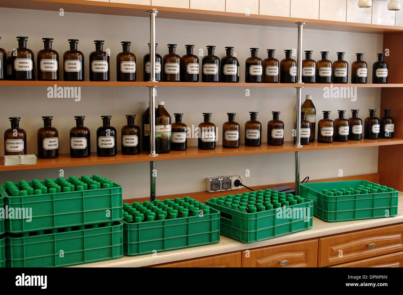 Glass bottles with herbal medicines standing on a shelf rack in the Knights Hospitallers pharmacy on May 2, 2011 in Krakow, Poland Stock Photo