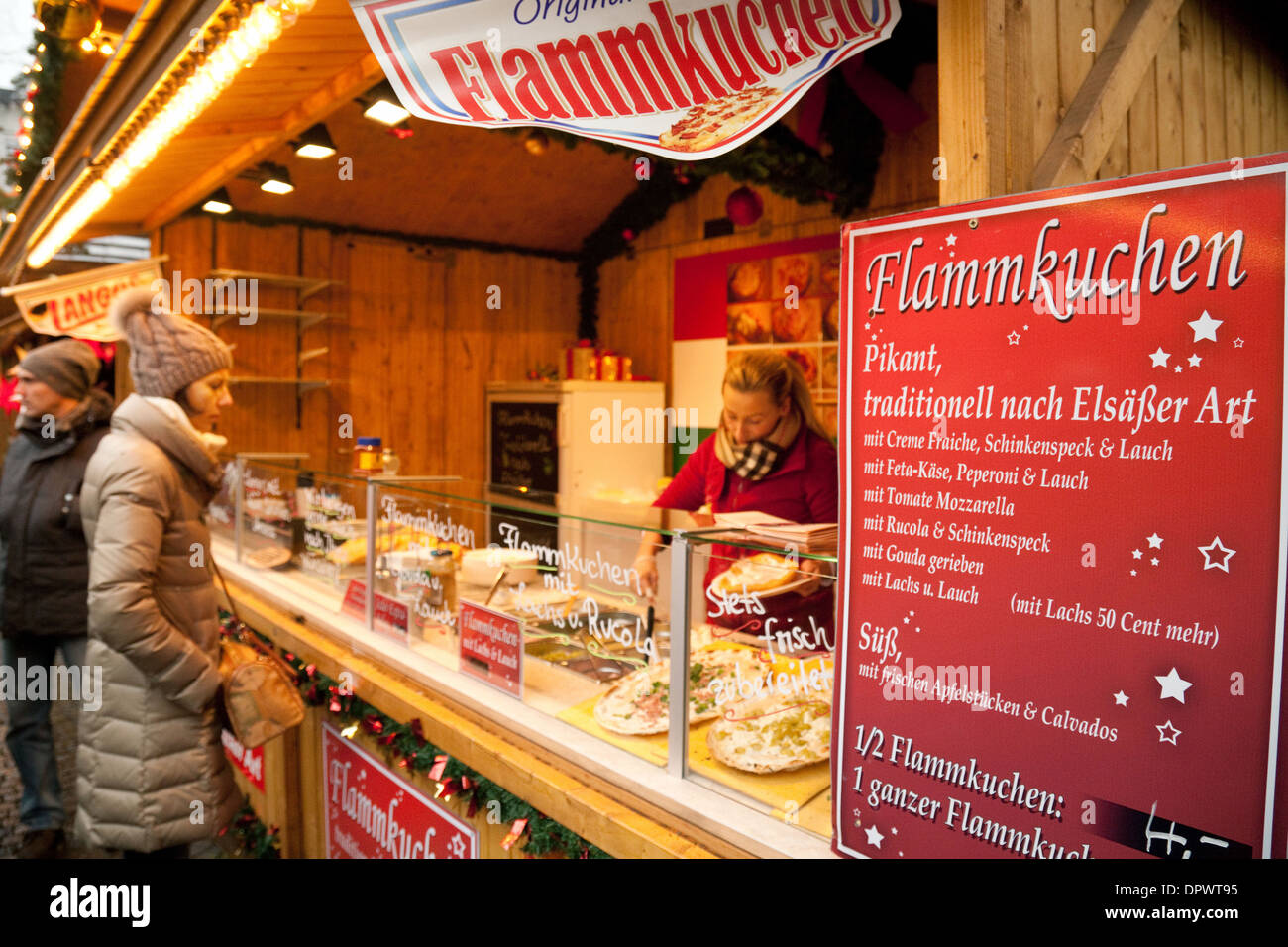 Cologne Christmas markets - a stall making and selling Flammkuchen, also known as Tarte Flambee or Flame Cake, Cologne Germany - Stock Image