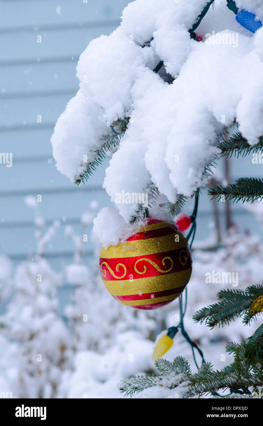 Christmas ornament snow snowing - Stock Image