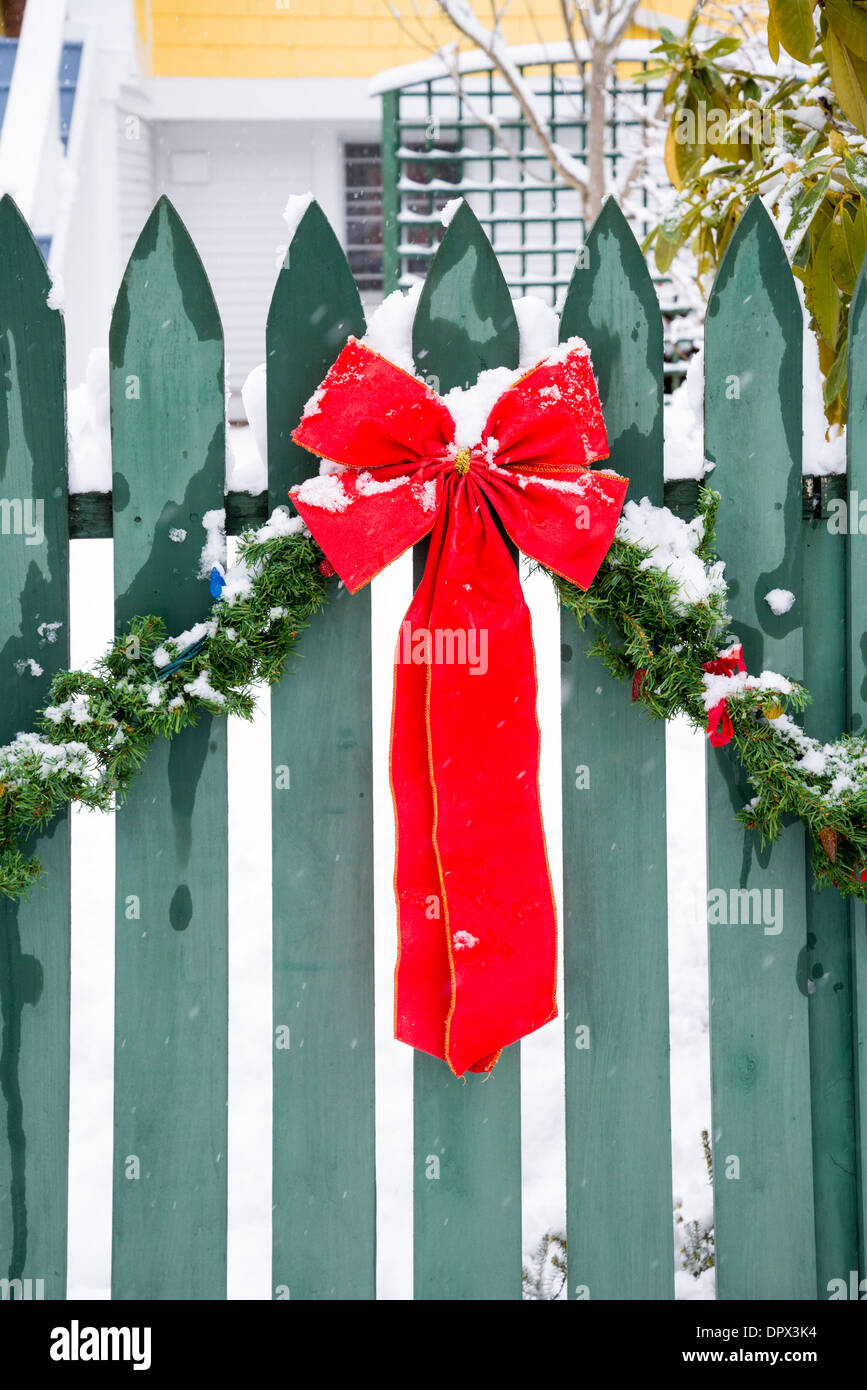 Christmas bow decoration and snow, - Stock Image