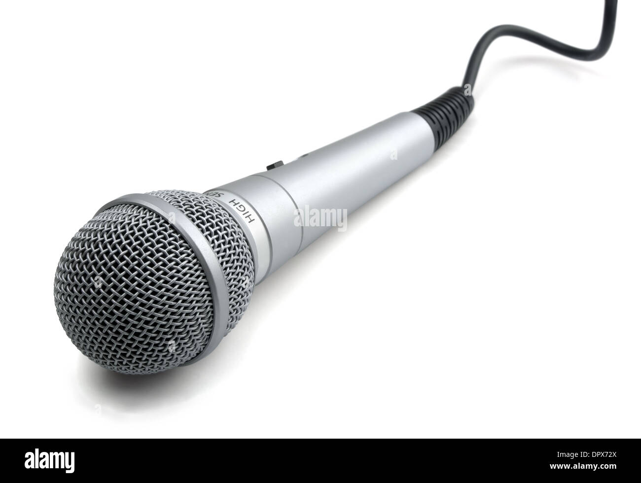 Silver microphone with black wire isolated on white - Stock Image