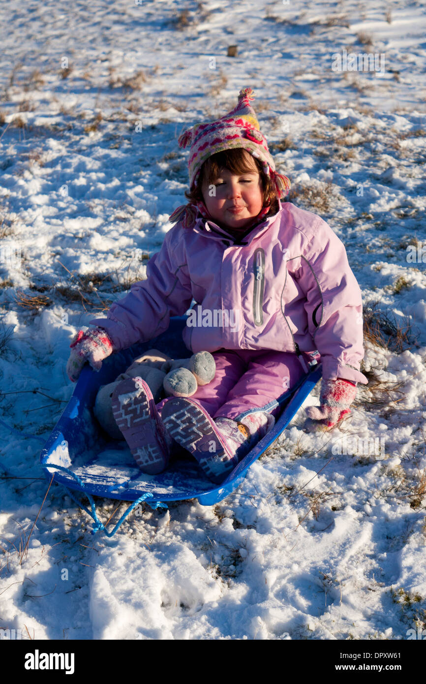 Young child on sled - Stock Image
