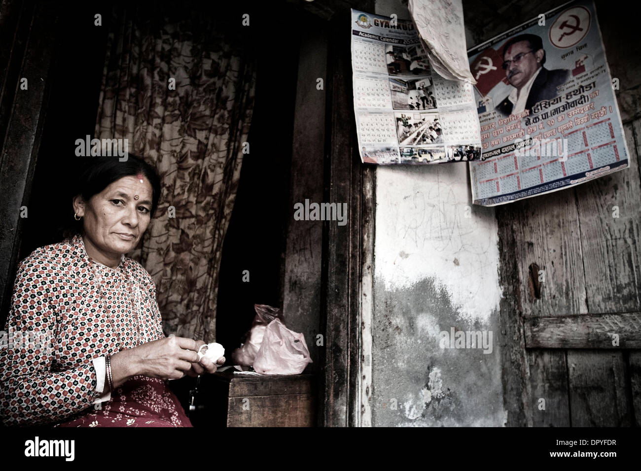 April 15, 2009 - Kathmandu, Nepal - A woman in her home. For the last three years, Nepal has been a Democratic Republic. Stock Photo