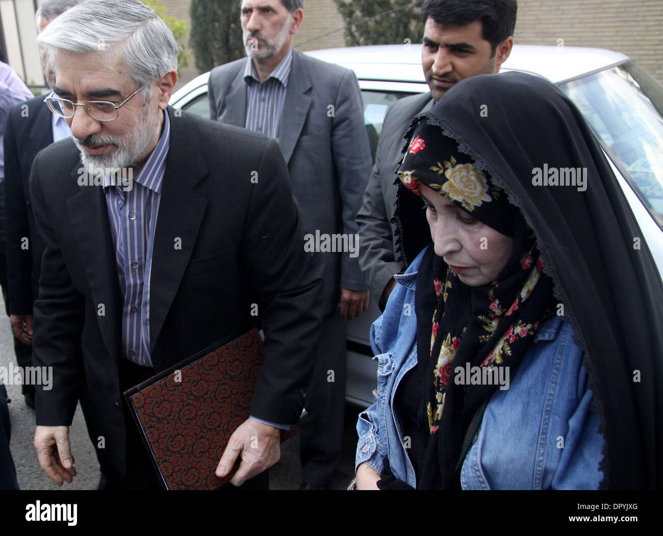 Apr 19, 2009 - Tehran, Iran - Former Iranian prime minister and candidate for the June 12 presidential election, Mir HOSSEIN MOUSAVI, 67, and his wife ZAHRA RAHNAVARD on their way to a meeting with artists and cultural people to talk about his programs about Iran's art and culture. Mousavi visited artists, directors, actors, writers, poets and other cultural people. He has chosen a - Stock Image