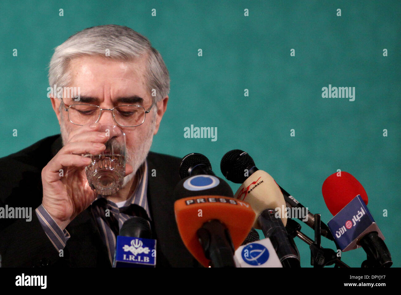 Apr 19, 2009 - Tehran, Iran - Former Iranian prime minister and candidate for the June 12 presidential election, Mir HOSSEIN MOUSAVI, 67, sips water during a meeting with artists and cultural people to talk about his programs about Iran's art and culture. Mousavi visited artists, directors, actors, writers, poets and other cultural people. He has chosen a 'Cultural government, non- - Stock Image