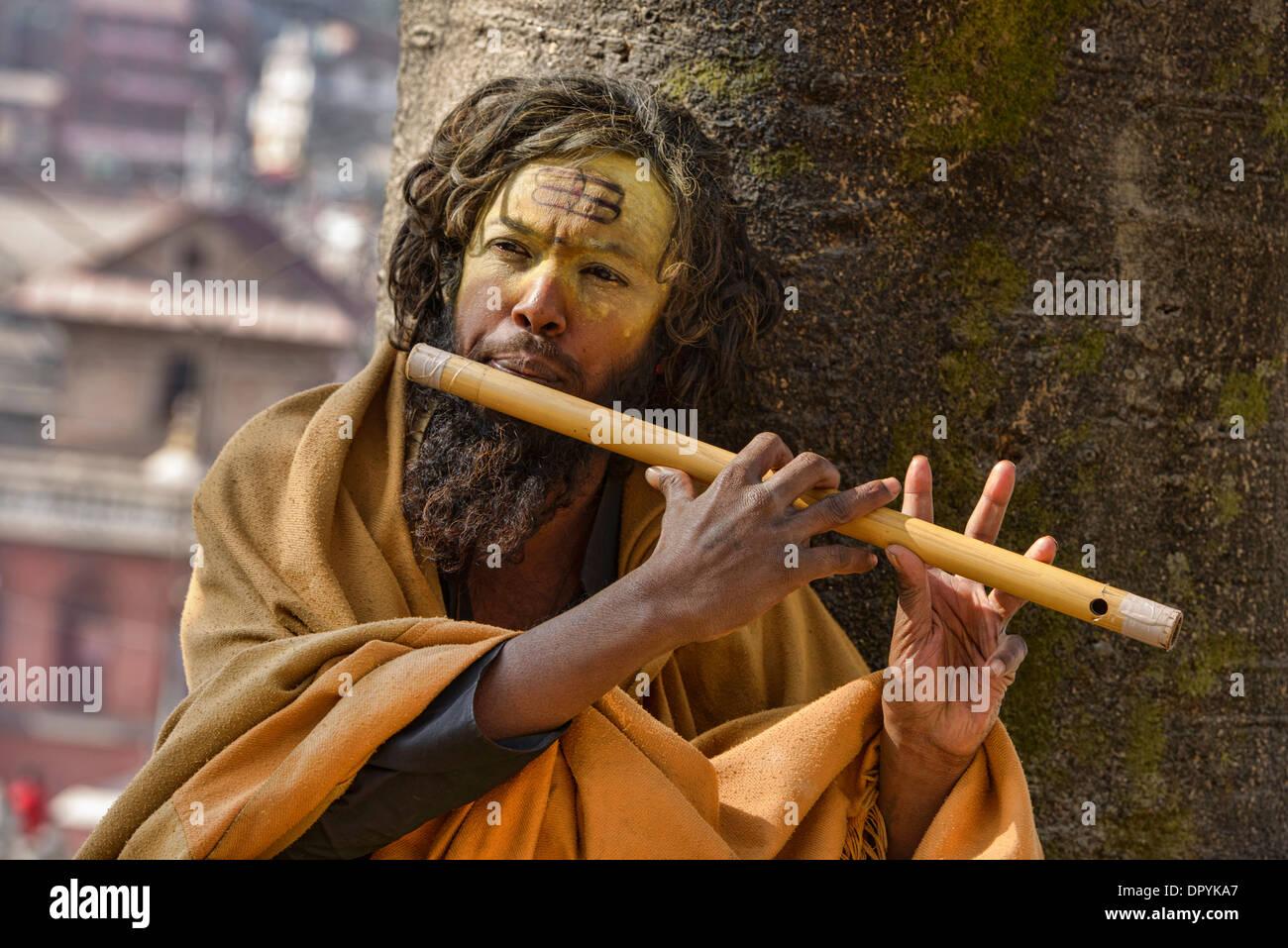 Sadhu playing a flute, Kathmandu, Nepal - Stock Image