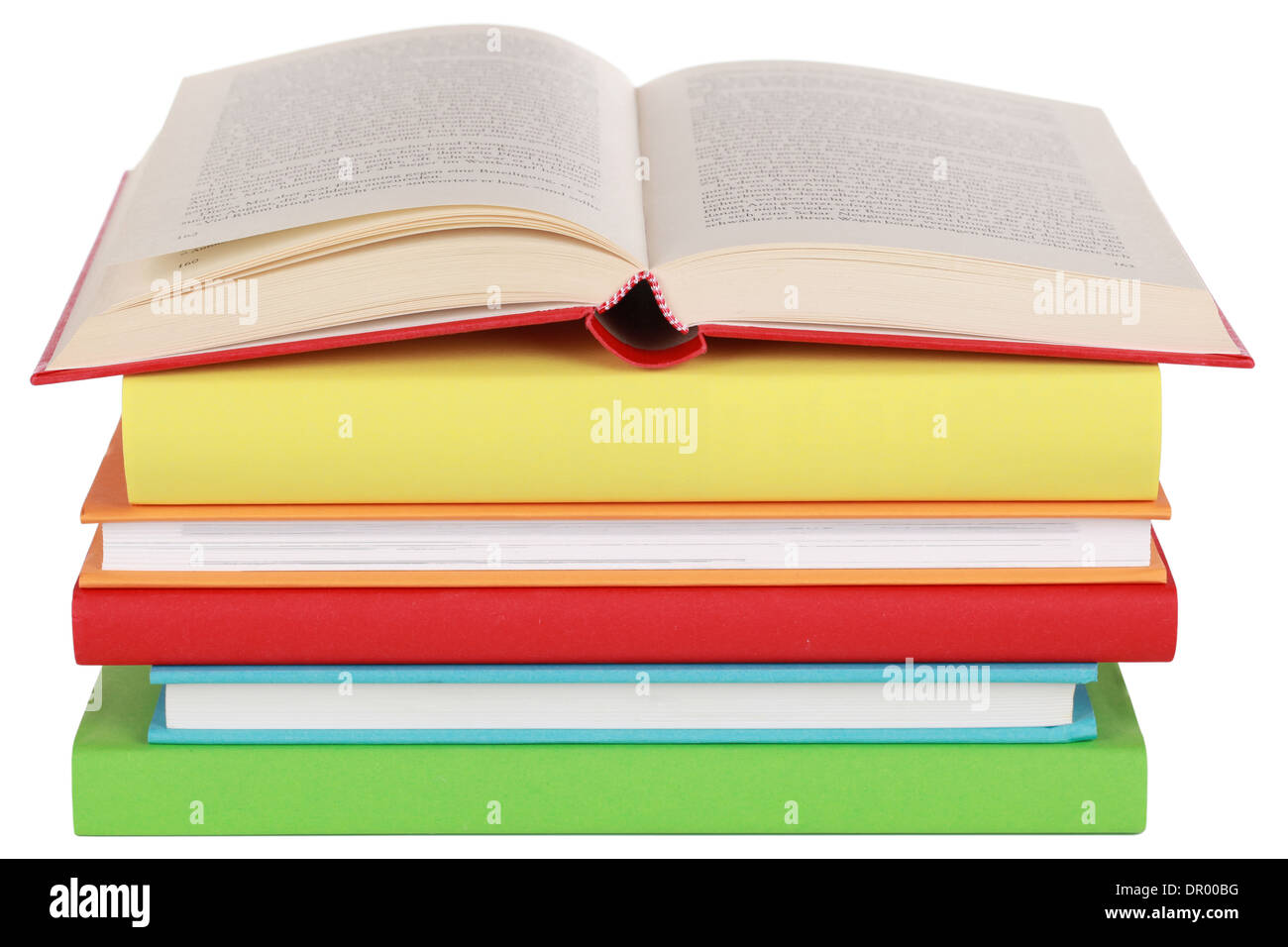 Opened book on a stack, isolated on a white background Stock Photo