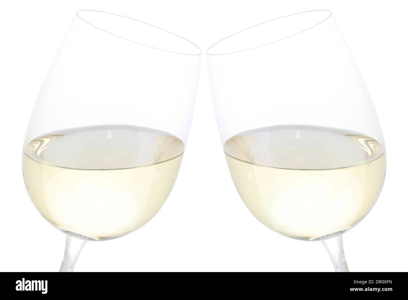 Clink glasses with white wine, isolated on a white background - Stock Image