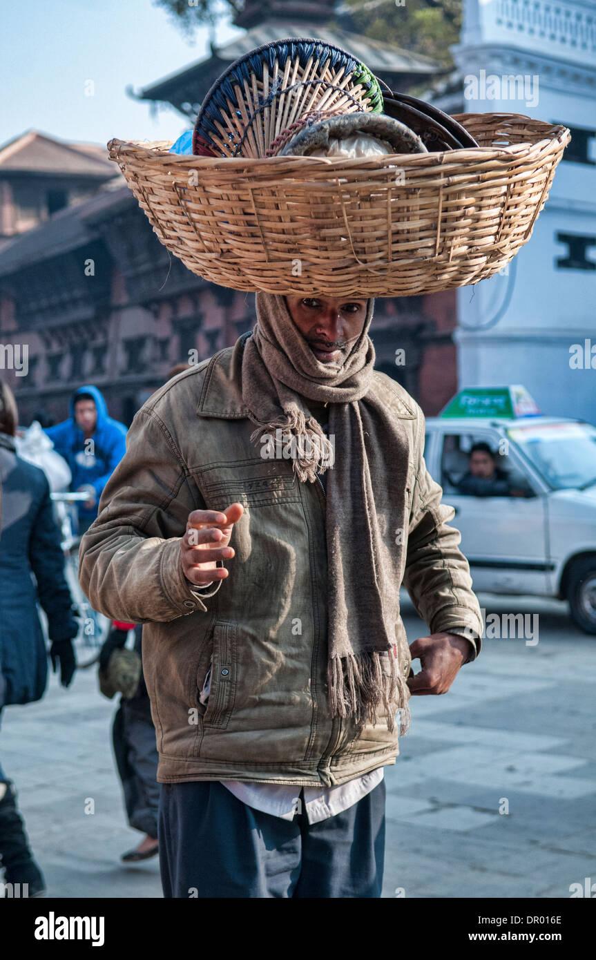 carrying a load on his head, Kathmandu, Nepal - Stock Image