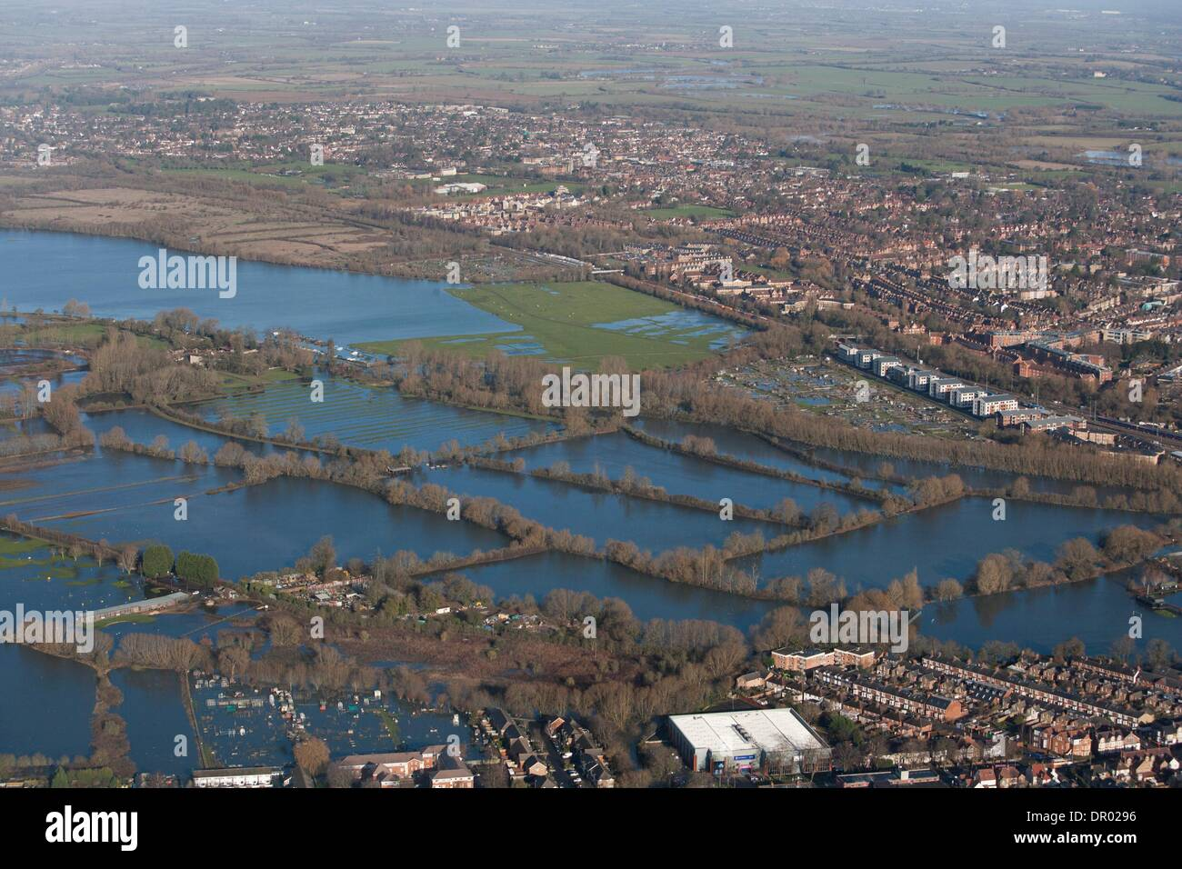 Oxford, UK. 14th January 2014. The  Thames, Oxford in  flood .  View North West over the Southern edge of Portmeadow   The  controversial Roger DudmanWay ( white) buildings  can be seen centre right bordering Portmeadow, hard up against the flooded allotments. Credit:  adrian arbib/Alamy Live News - Stock Image