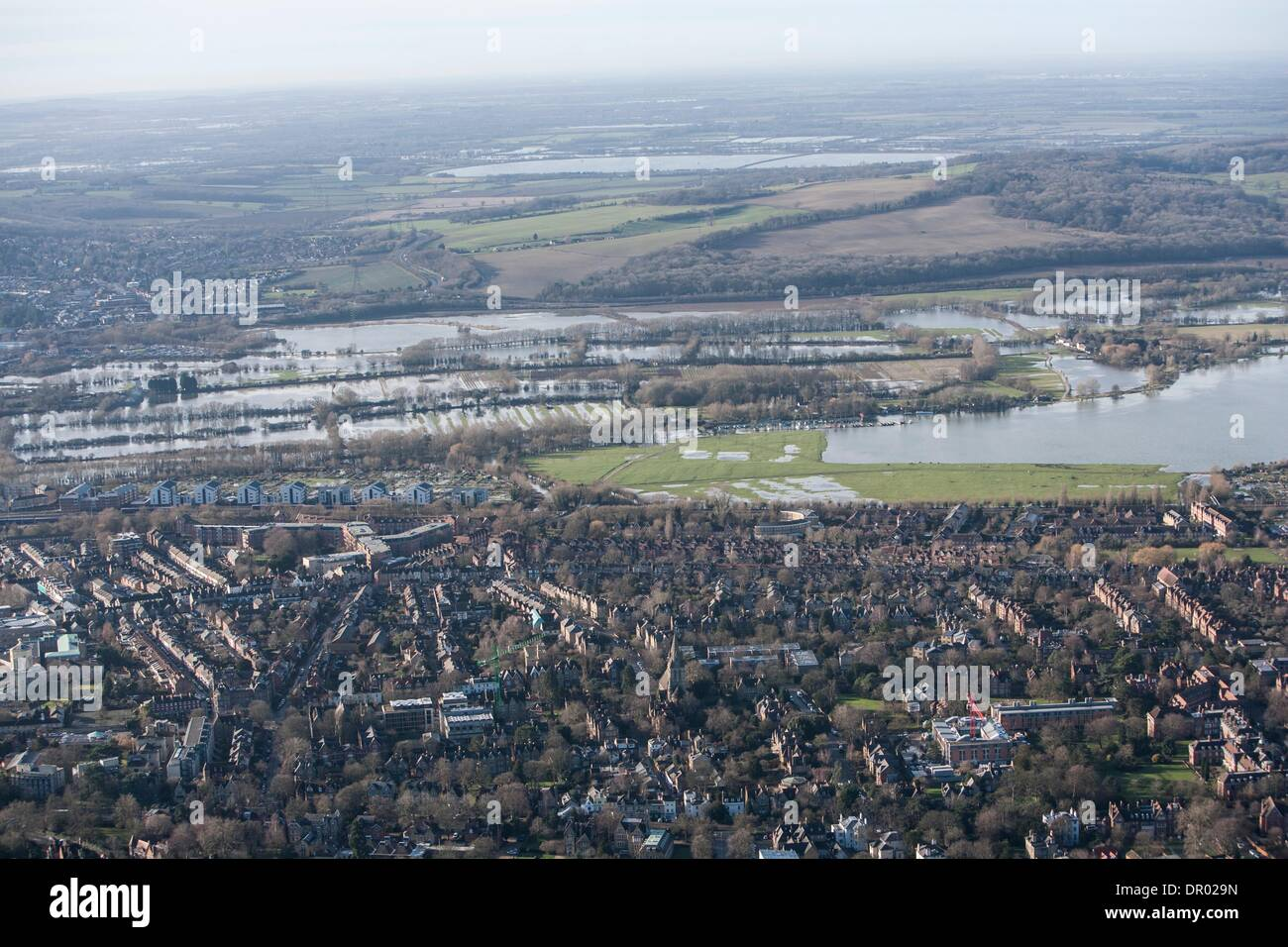 Oxford, UK. 14th January 2014. The  Thames, Oxford in  flood .  View over North Oxford  west  towards Binsey  and the southern edge of  Portmeadow, a natural flood plain.  The controversial University buildings of Roger Dudman Way  can  be seen ( centre left )  along railway lines. Credit:  adrian arbib/Alamy Live News - Stock Image