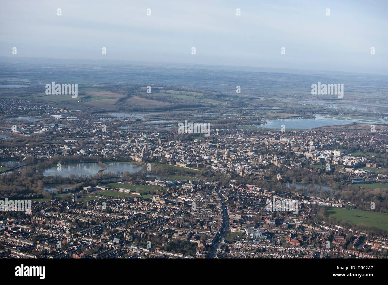 Oxford, UK. 14th January 2014. The  Thames, Oxford in  flood .  View of Oxford, looking  North West over St Clements, East Oxford and the Cowley road,   with  Portmeadow to the top , a natural flood plain. Credit:  adrian arbib/Alamy Live News - Stock Image