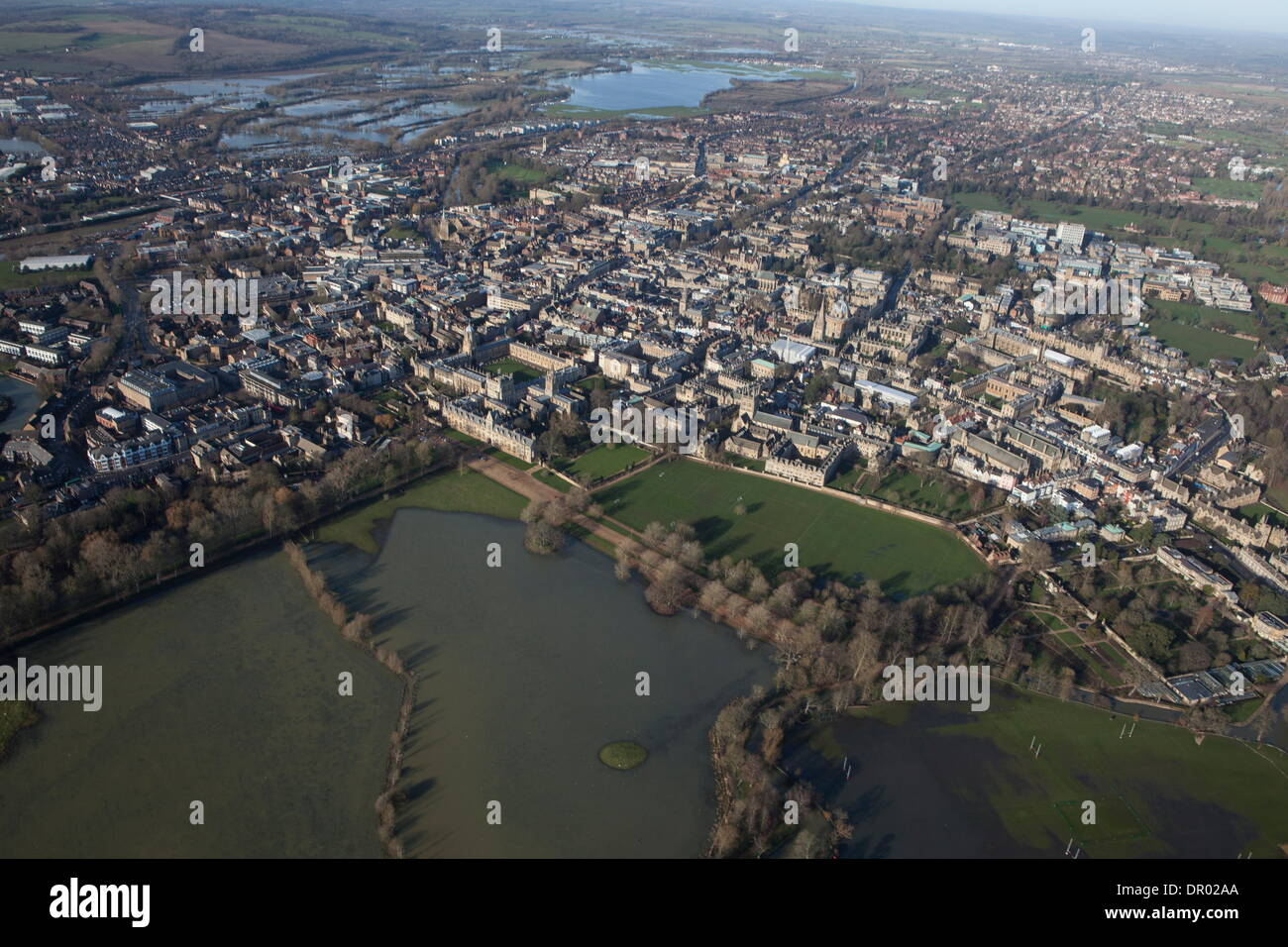 Oxford, UK. 14th January 2014. The Thames, Oxford in  flood .  View of Oxford, North West  with Portmeadow to the top , a natural flood plain.  The controversial University buildings  of Roger Dudman Way  can  be seen ( centre )  along railway lines on the southern edge of Portmeadow Credit:  adrian arbib/Alamy Live News - Stock Image