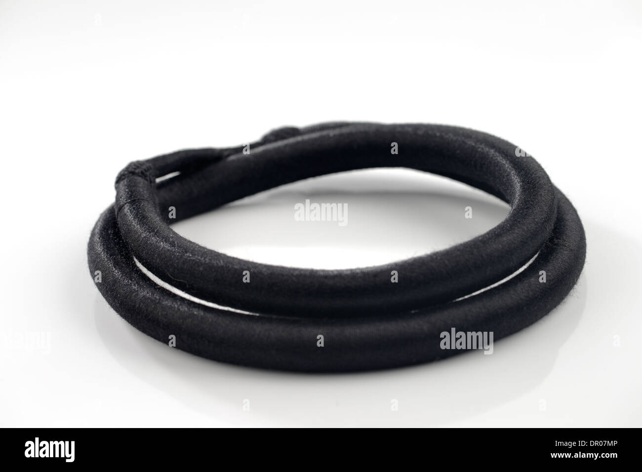 The agal is an accessory worn usually by Arab men. It is a black cord, worn doubled, used to keep the ghutrah in place - Stock Image