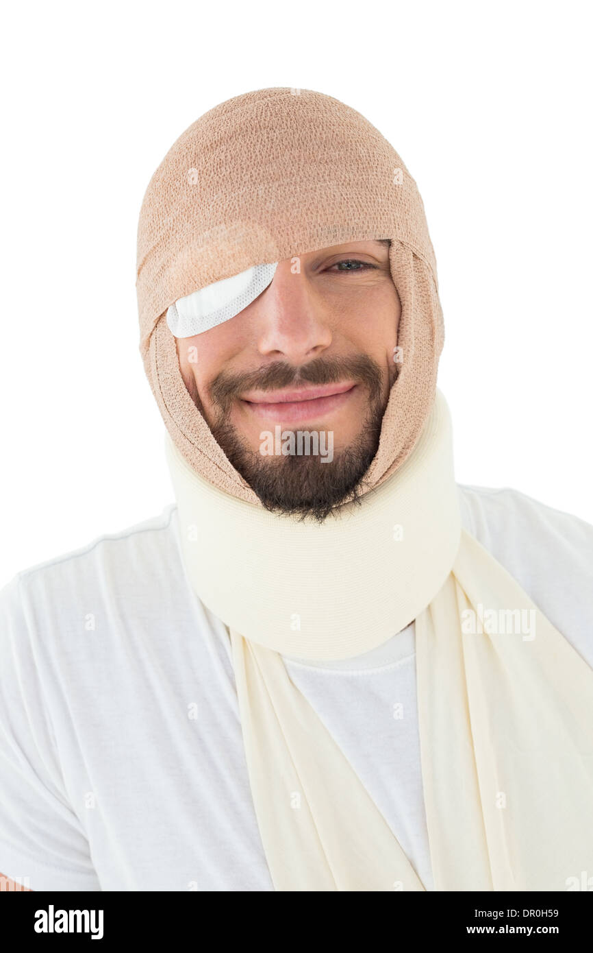 Close-up portrait of a man with head tied up in bandage - Stock Image