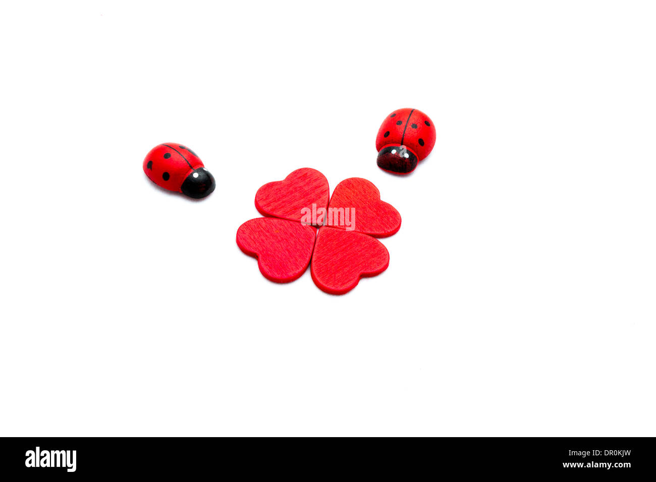 Clover and ladybugs for Valentines Day concept - Stock Image