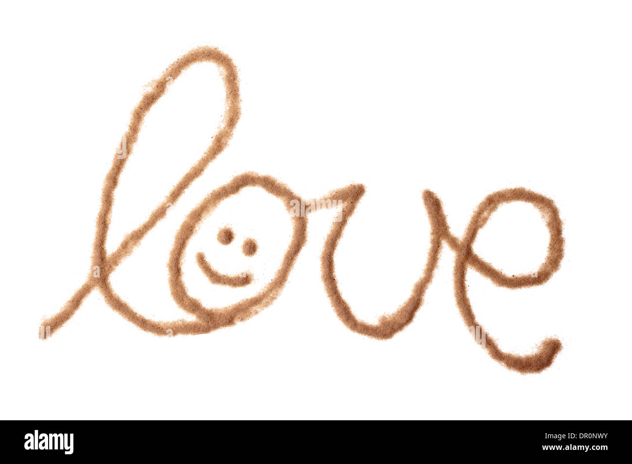 The word love with smileay face written with sand - Stock Image