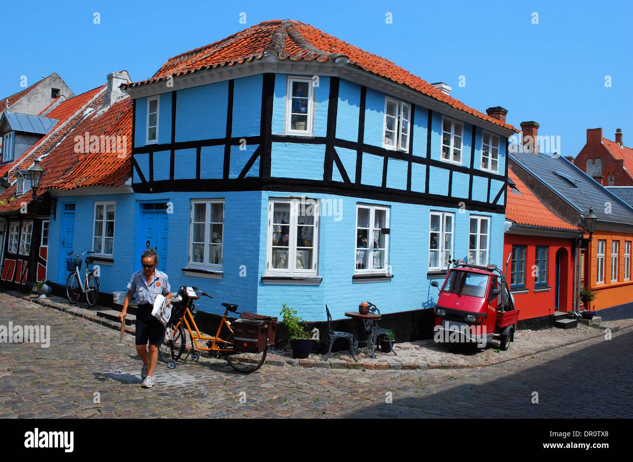 Aero island, Aeroskobing, postwoman at work, fyn, Denmark, Scandinavia, Europe - Stock Image