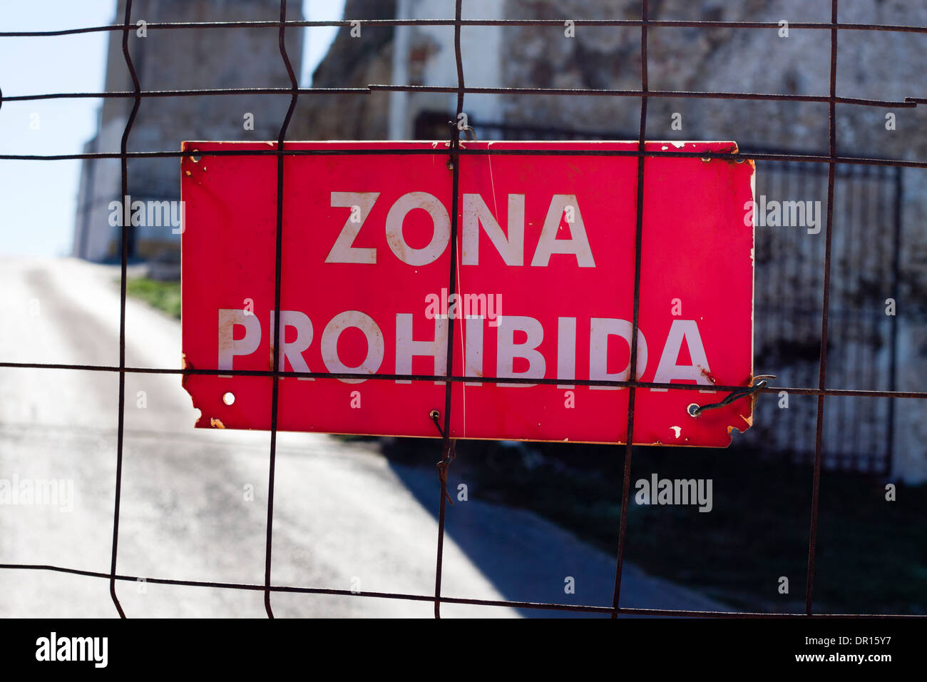 Zona Prohibida, red no entry sign on the fence in Spanish language. - Stock Image