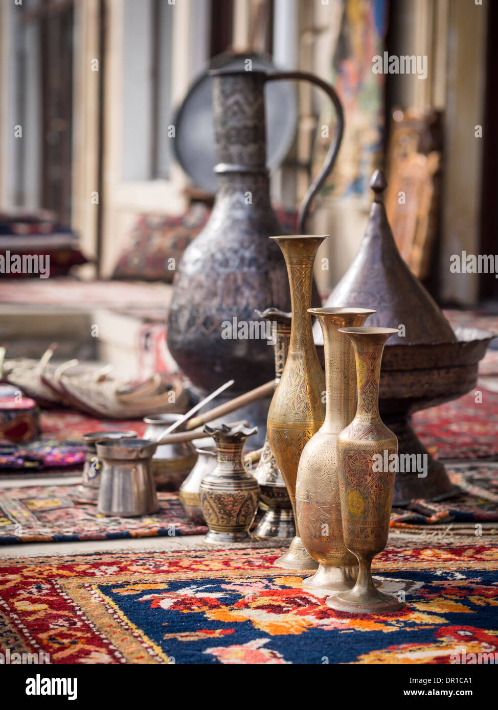 Metal containers and other souvenirs sold on a local market in the old town of Baku, Azerbaijan. - Stock Image