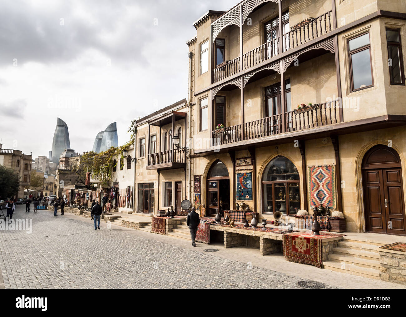 The Old Town (Icheri Sheher) of Baku, Azerbaijan. Flame Towers in the background. - Stock Image