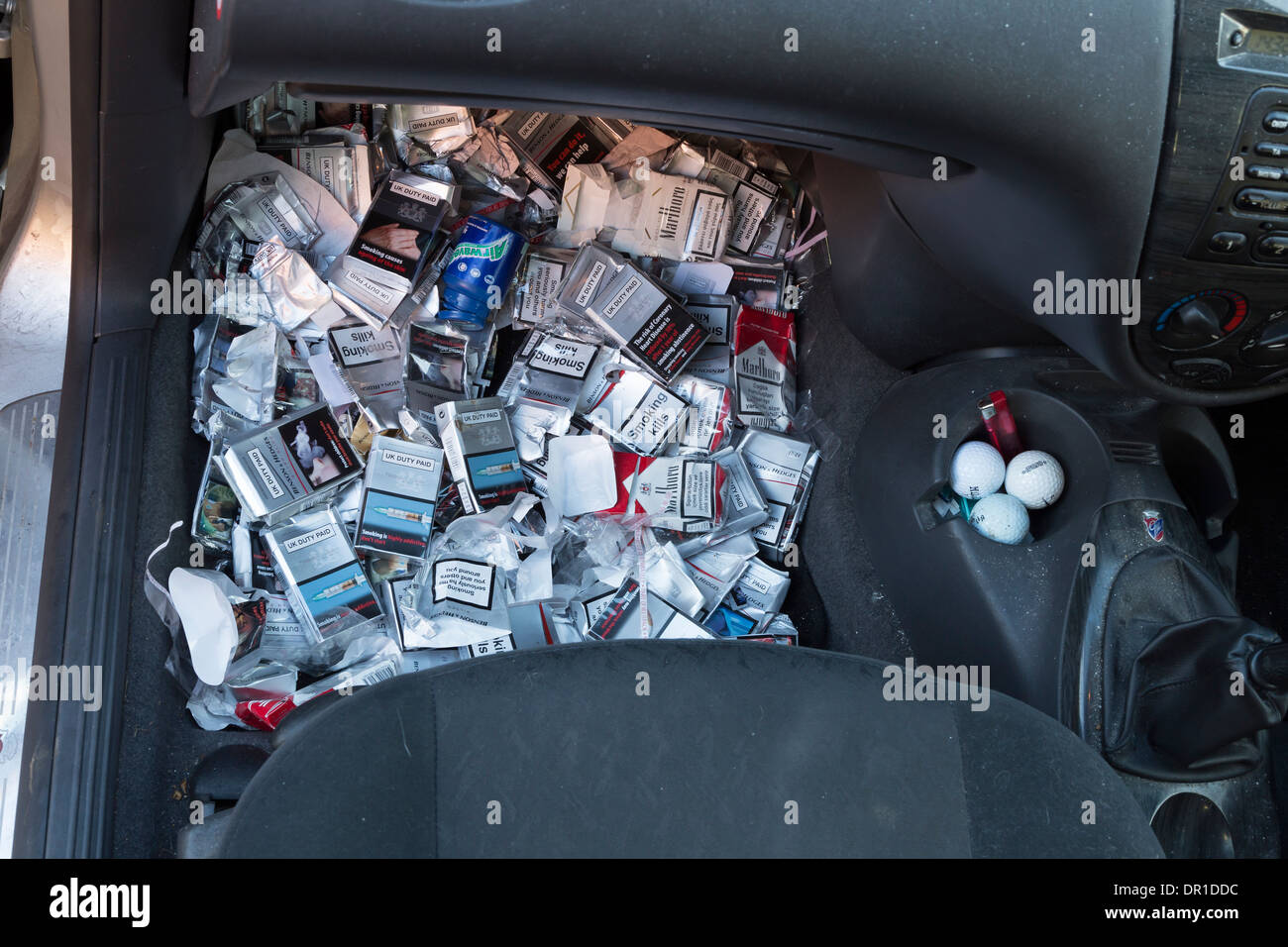 MANY DISCARDED CIGARETTE PACKETS THROWN ON THE FLOOR OF A FORD FOCUS CAR, BY A SMOKER. - Stock Image