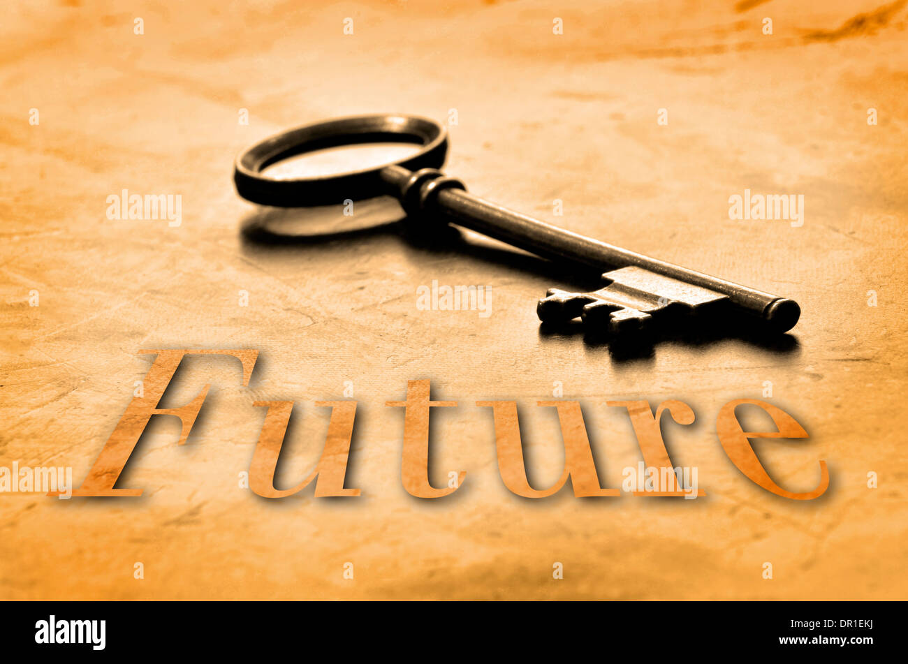 Key to the Future on an old worn wooden desk top - Stock Image
