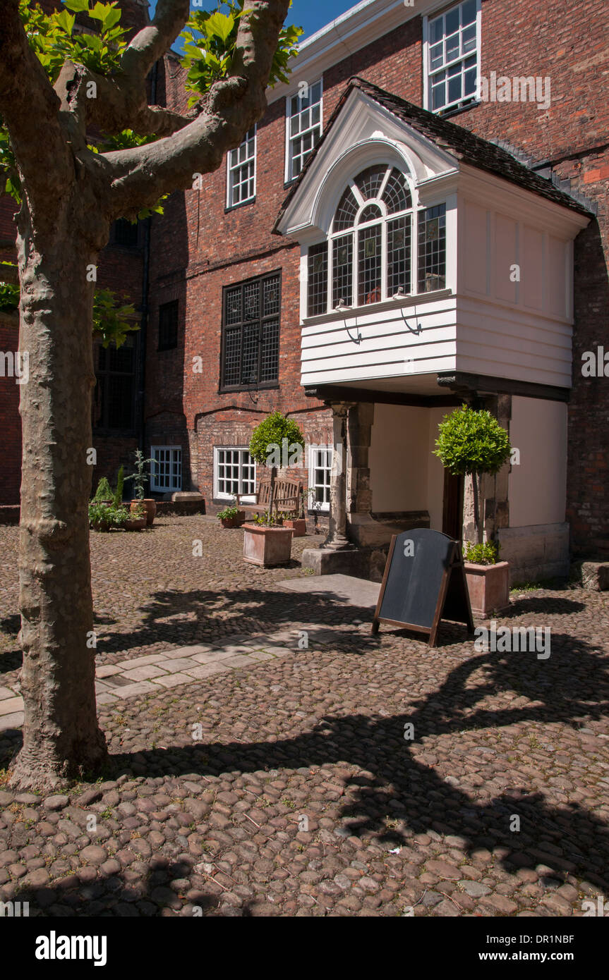 Entrance porch, doorway & cobbled courtyard of historic Grade 1 listed building - Grays Court hotel & restaurant, York, North Yorkshire, England, UK. - Stock Image