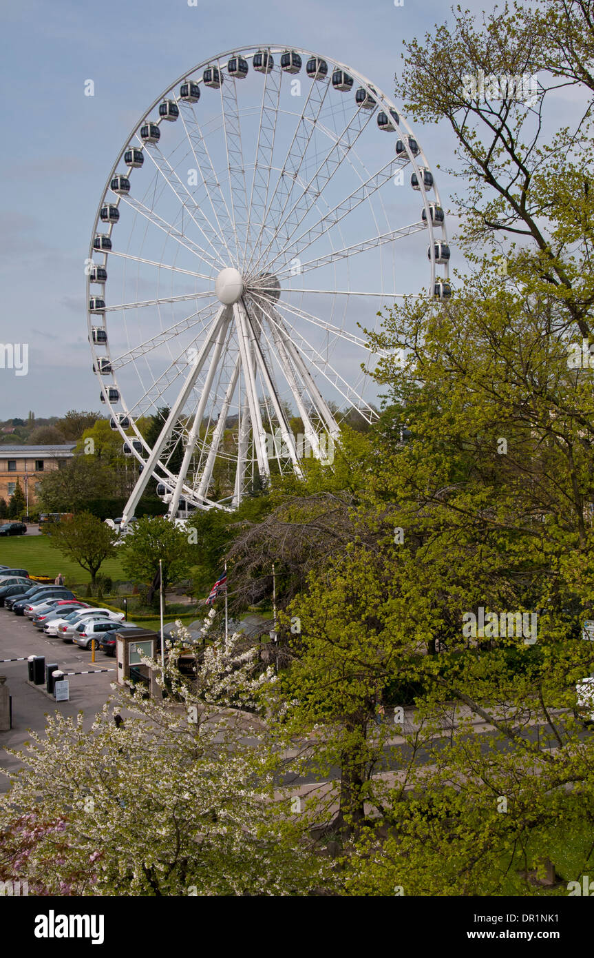 Towering white metal structure, York Wheel tourist attraction, in grounds of Royal York Hotel (now The Principal) - York, North Yorkshire, England. - Stock Image