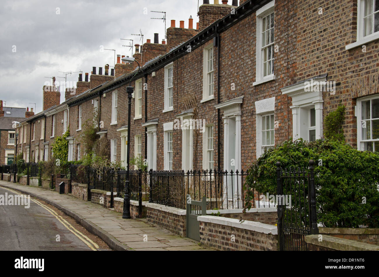 Attractive Grade 2 listed Victorian terrace of houses with small front gardens & railings - Dewsbury Terrace, York, North Yorkshire, England, UK. - Stock Image