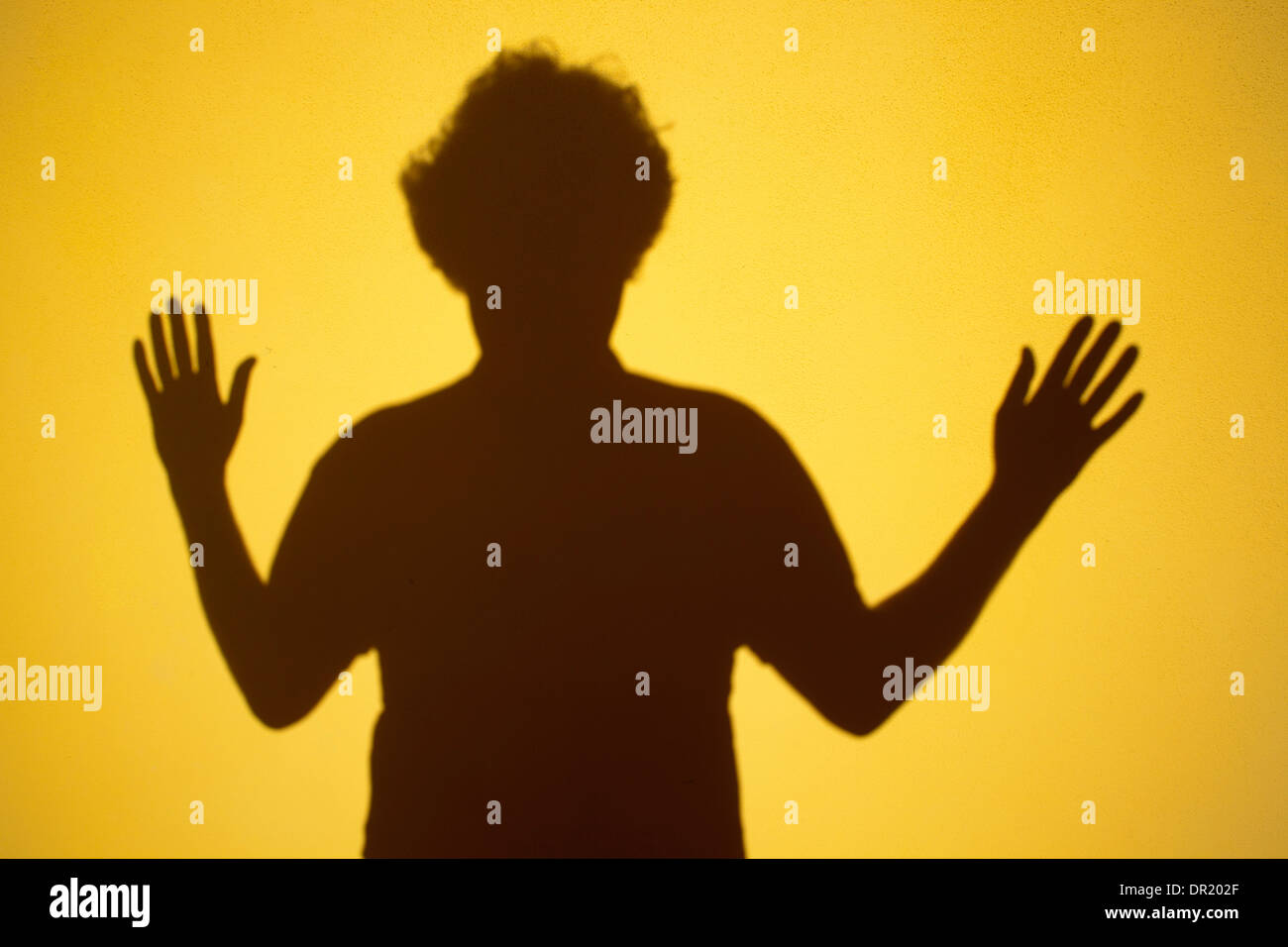 hands up, shadow on a yellow wall, italy, europe - Stock Image