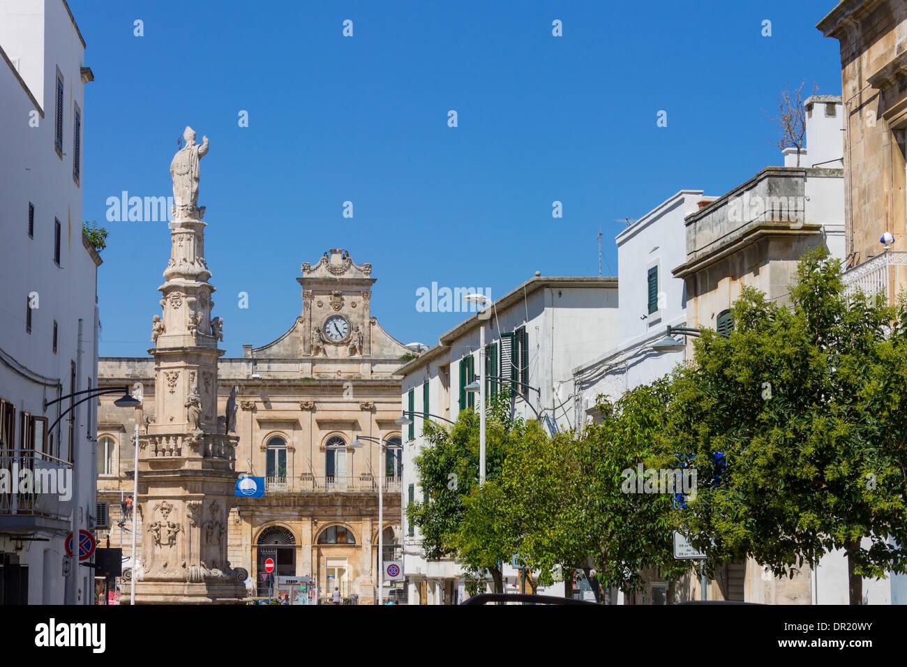 Italy, Apulia, Ostuni, Piazza della Libertà, St. Oronzo monument and city hall - Stock Image