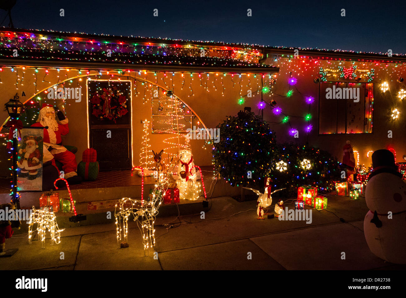home decorated with christmas lights and decorations on street in hispanic district of santa barbara