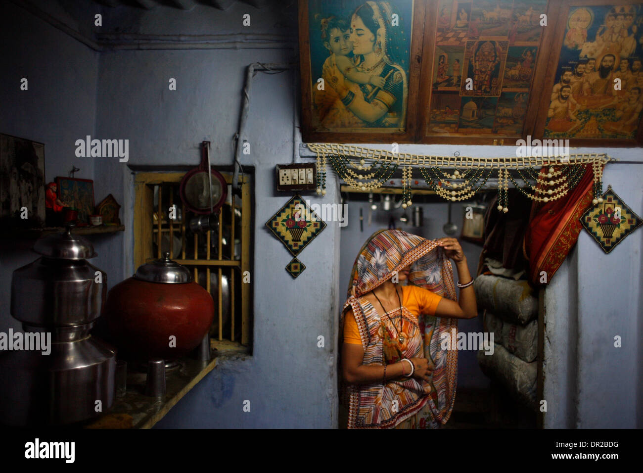 Jan. 12, 2009 - Amhedabad, India - CHANDRIKA DODIYA stands in the doorway of her kitchen where she lives with her Stock Photo