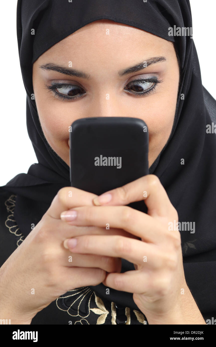 Arab woman addicted to the smartphone isolated on a white background - Stock Image