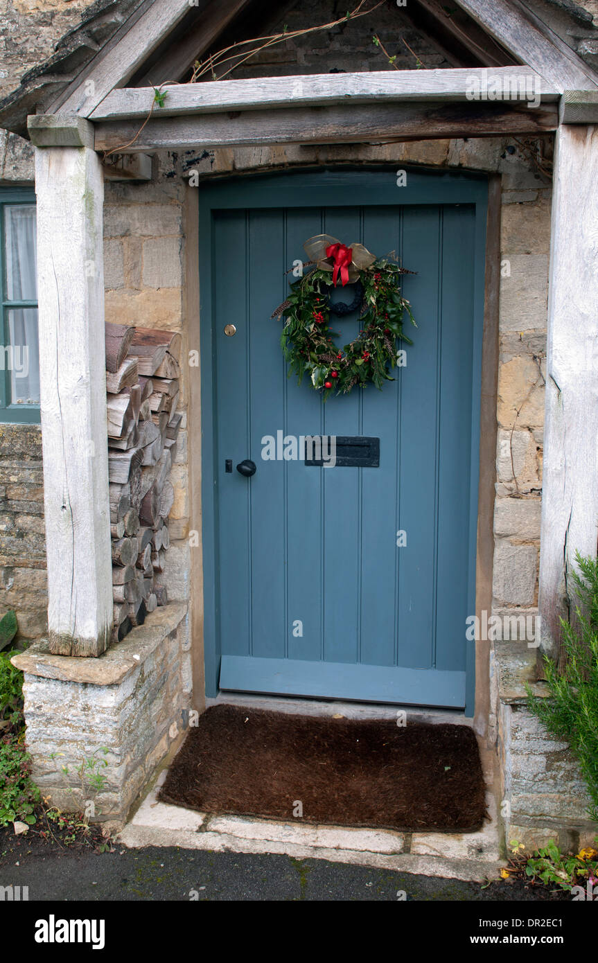 Christmas wreath on a Cotswolds cottage door & Christmas wreath on a Cotswolds cottage door Stock Photo: 65823409 ...