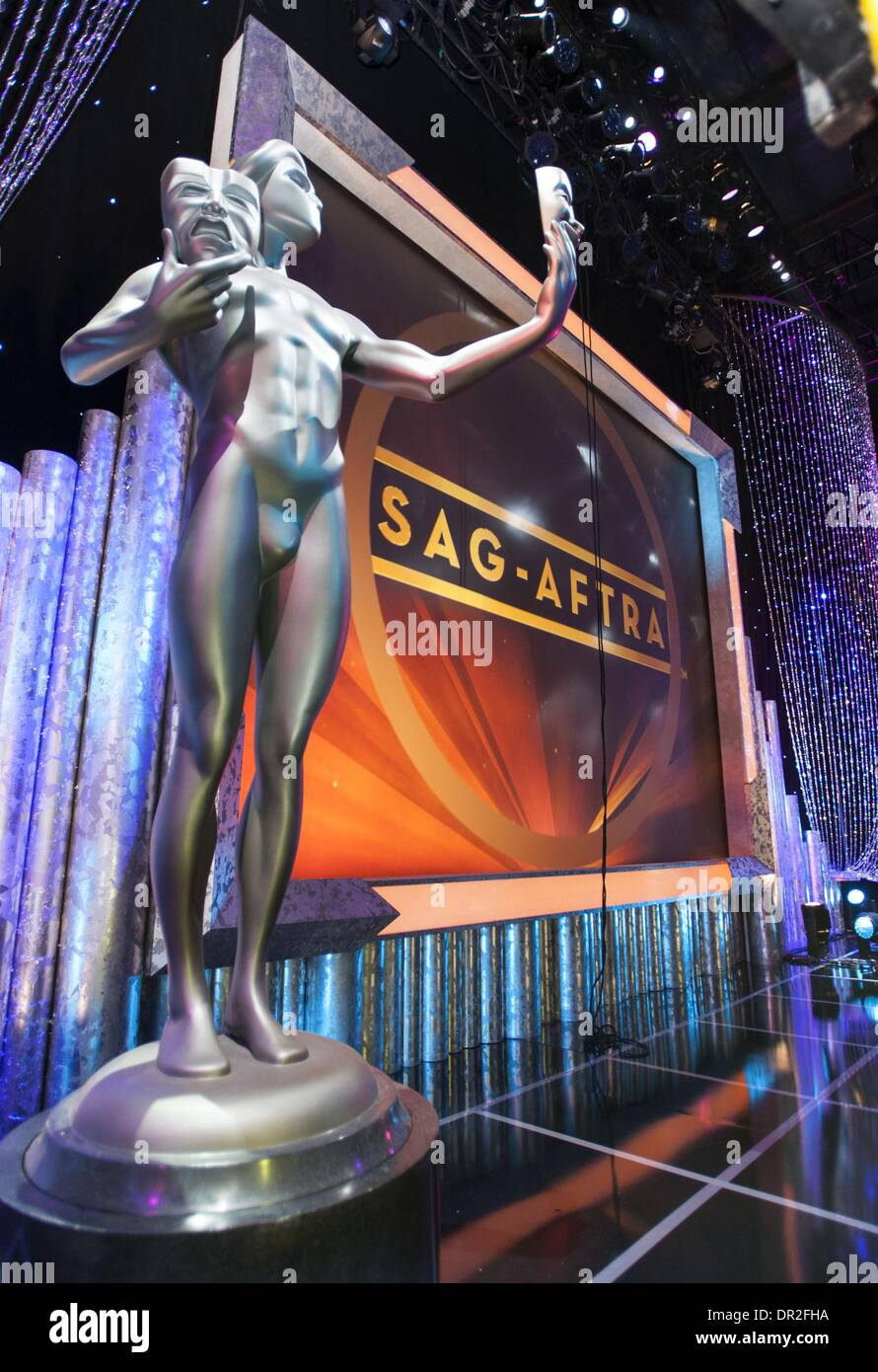 Los Angeles, California, USA. 17th Jan, 2014. A larger than life SAG Award Statuette on stage as a back drop at the Shrine Auditorium. The Screen Actors Guild made their final preparations on Friday morning for what will be this year's 20th SAG Awards event Saturday. Set-up crews pulled out the red carpet as they finalized lighting and TV camera locations. The Screen Actors Guild Awards (also known as the SAG Awards) is given to recognize outstanding performances in film and primetime television. Credit:  David Bro/ZUMAPRESS.com/Alamy Live News - Stock Image