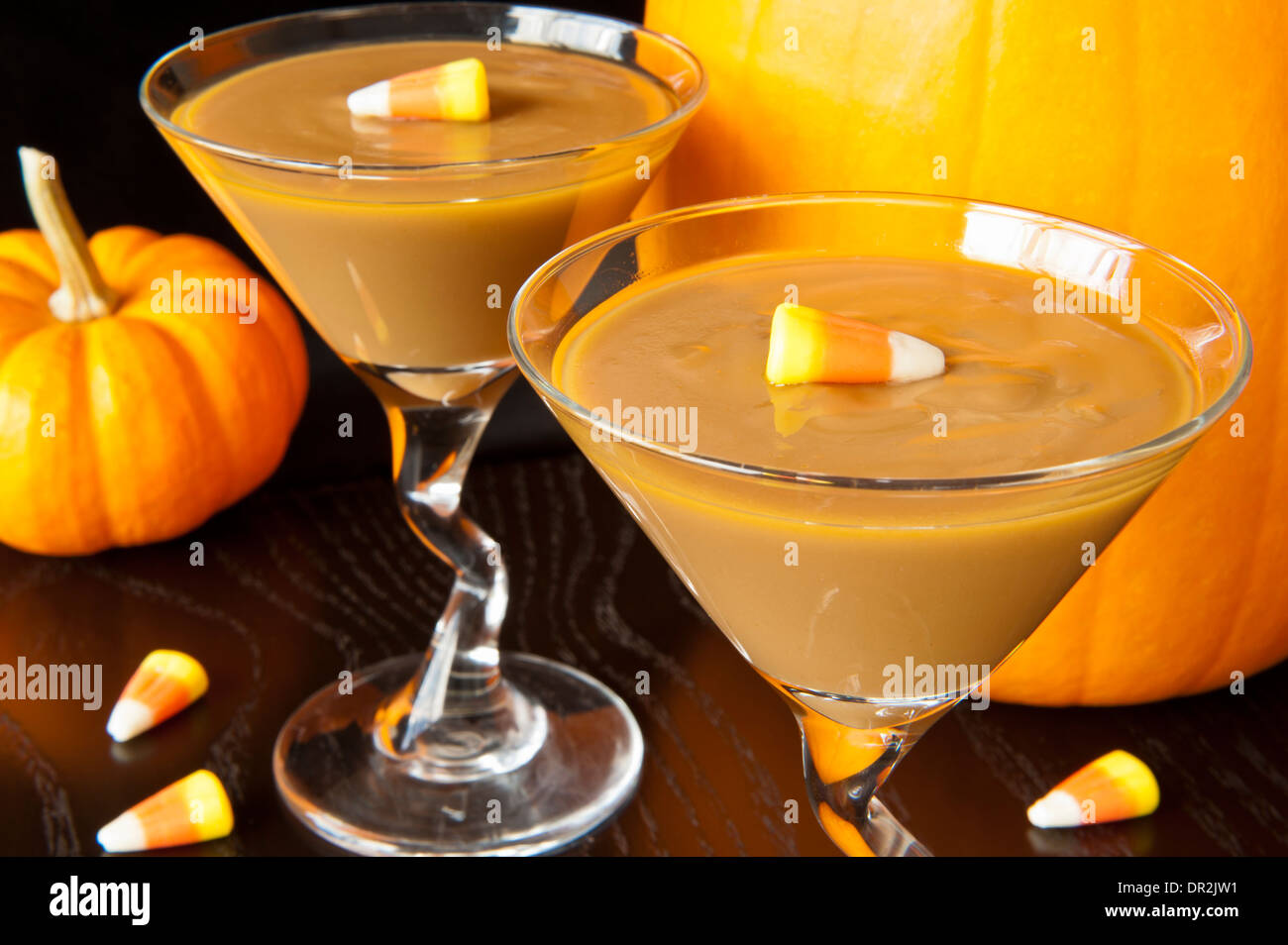 Caramel pudding with candy corns and pumpkins - Stock Image