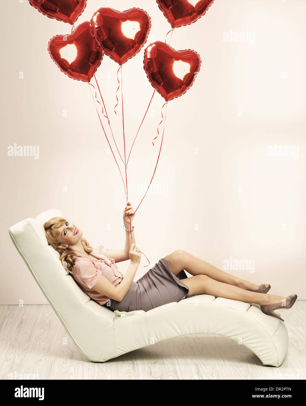 Alluring blonde woman preparing for valentine's day - Stock Image