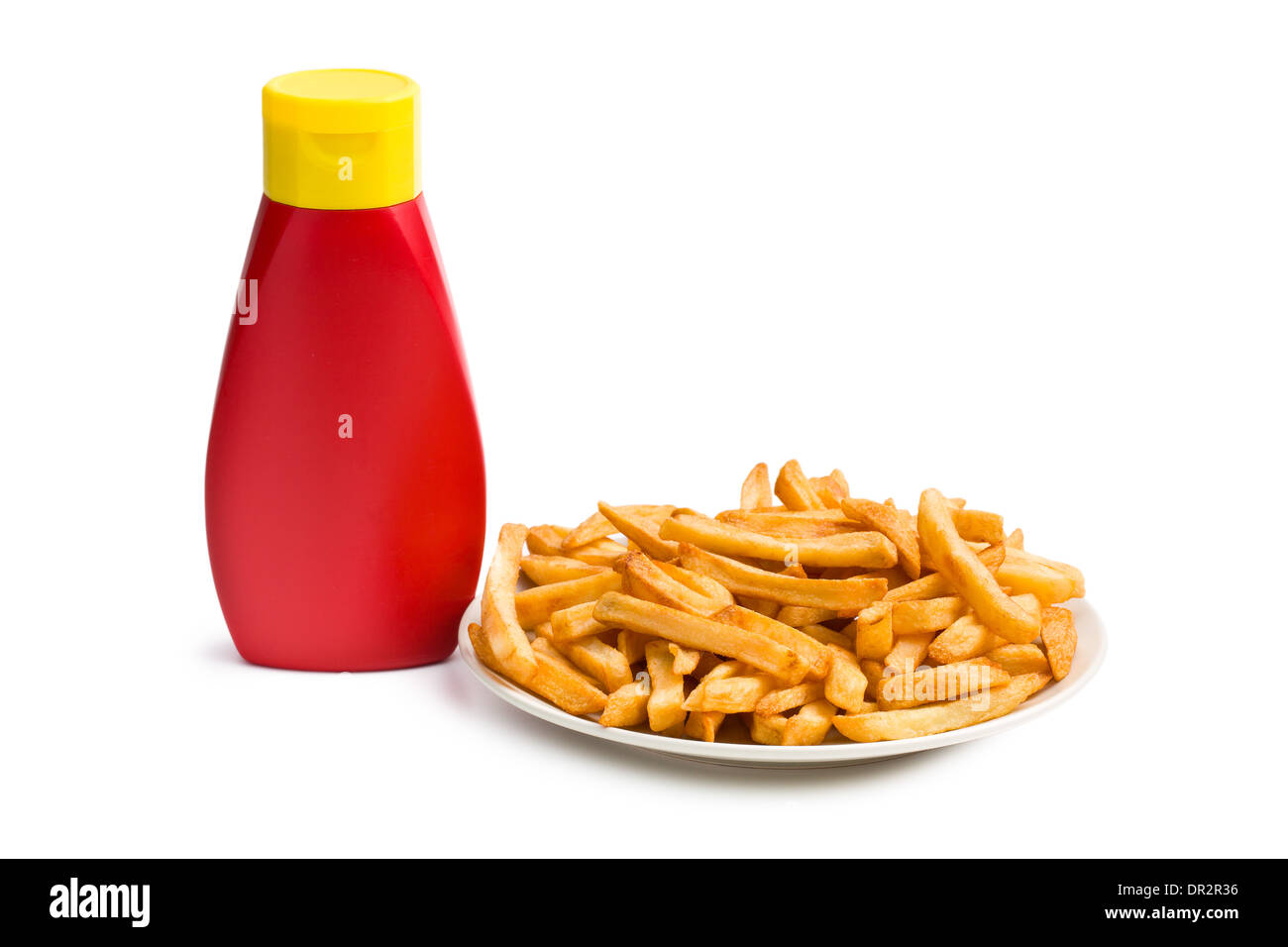 french fries with bottle of ketchup on white background - Stock Image