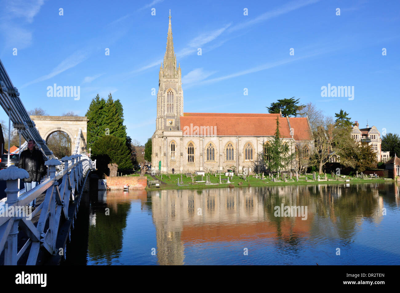 Bucks - Marlow on Thames - over the river - imposing All Saints church - tall steeple- red tiles - buff stonework - reflections - Stock Image