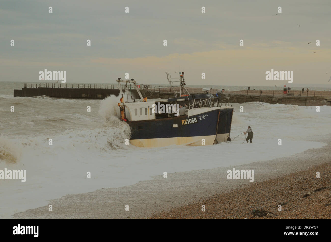 Hastings, East Sussex, UK. 18th Jan, 2014. Sea remains very choppy on the South Coast and landing looks risky as some fishing resumes. The industry has been hit very hard by the weather. Credit:  David Burr/Alamy Live News - Stock Image
