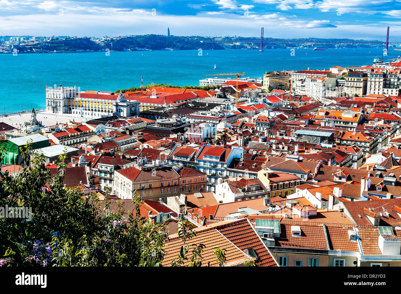 Bird view of central Lisbon with colorful houses and orange roofs - Stock Image