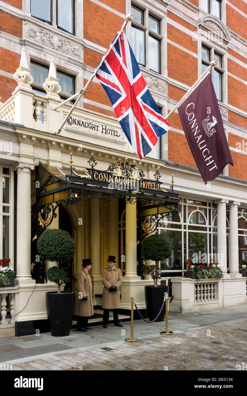 Doorman outside the prestigious Connaught Hotel, Mayfair, London - Stock Image
