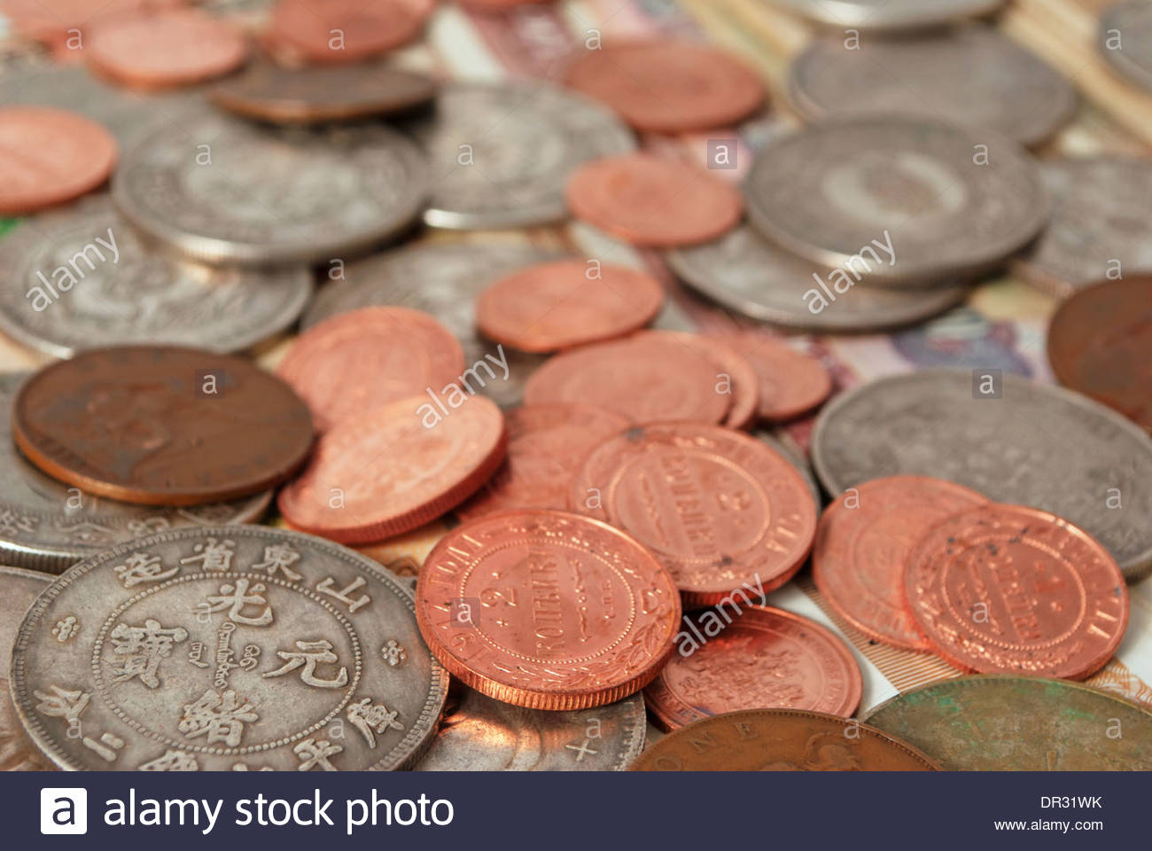 Coins and banknotes of different countries. - Stock Image