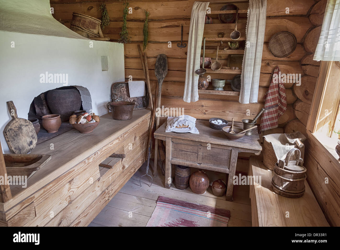 The interior of the museum Suvorov. Russian traditional kitchen with stove. Generalissimo A. Suvorov is a great russian warlord - Stock Image