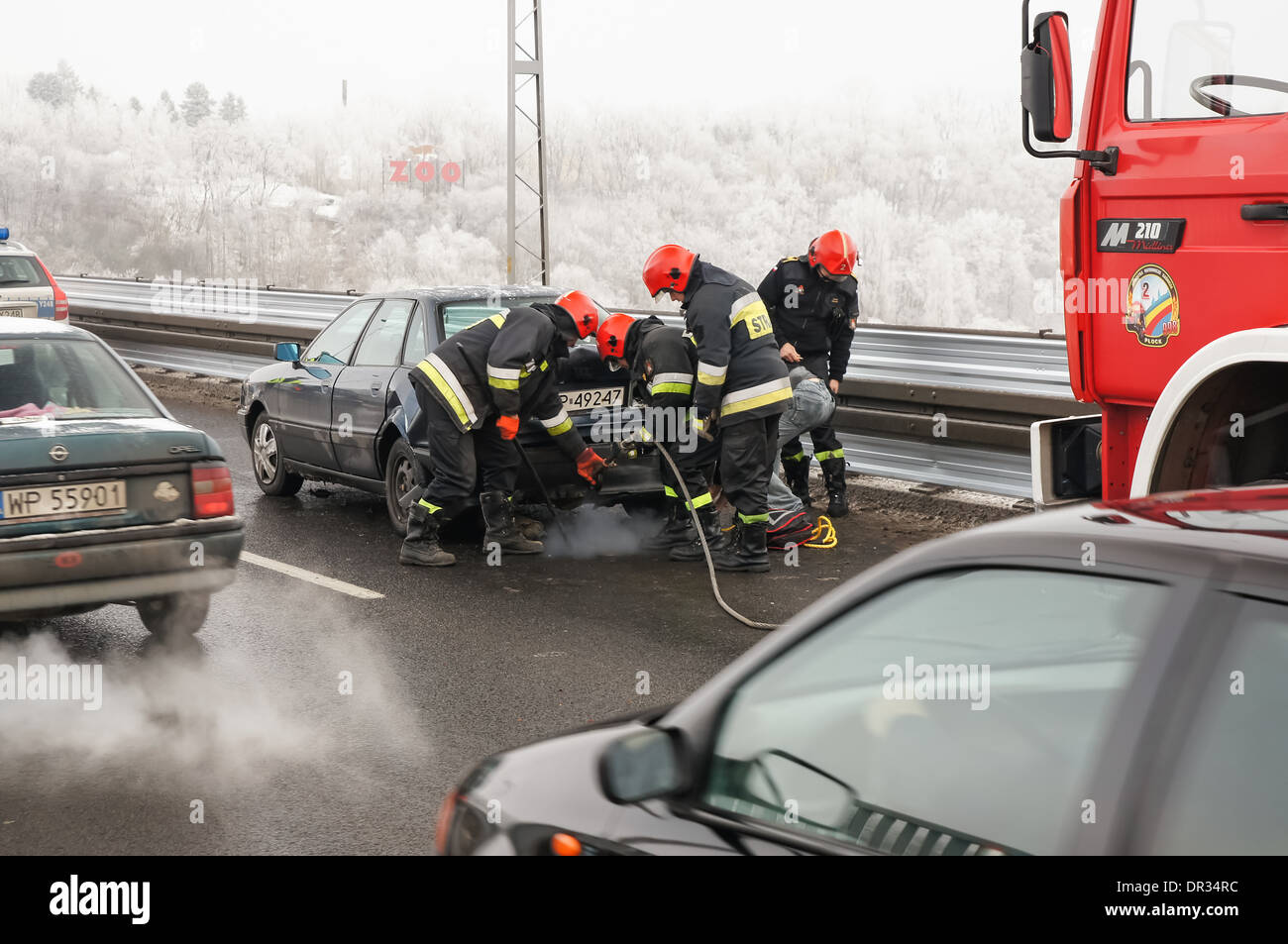 Firefighters Help In A Car Accident On The Bridge Above Vistula