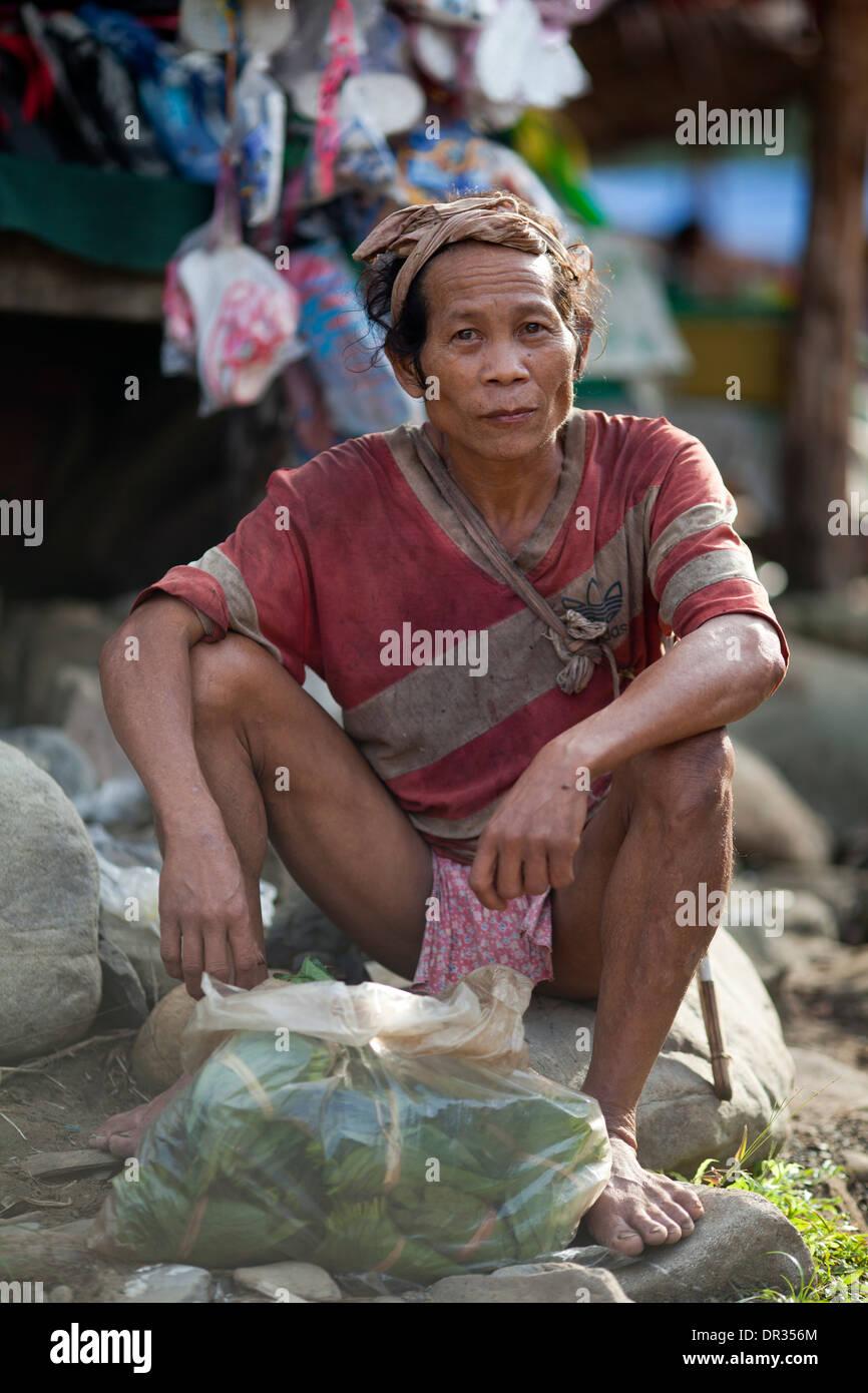 A Hanunoo Mangyan man at a Mangyan market near Mansalay, Oriental Mindoro, Philippines. - Stock Image