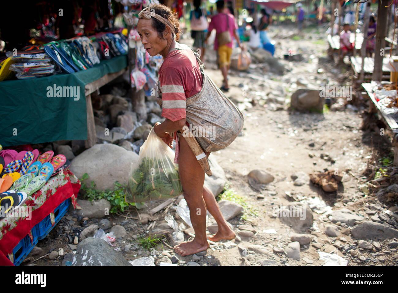 A Hanunoo Mangyan shops at a Mangyan market near Mansalay, Oriental Mindoro, Philippines. - Stock Image